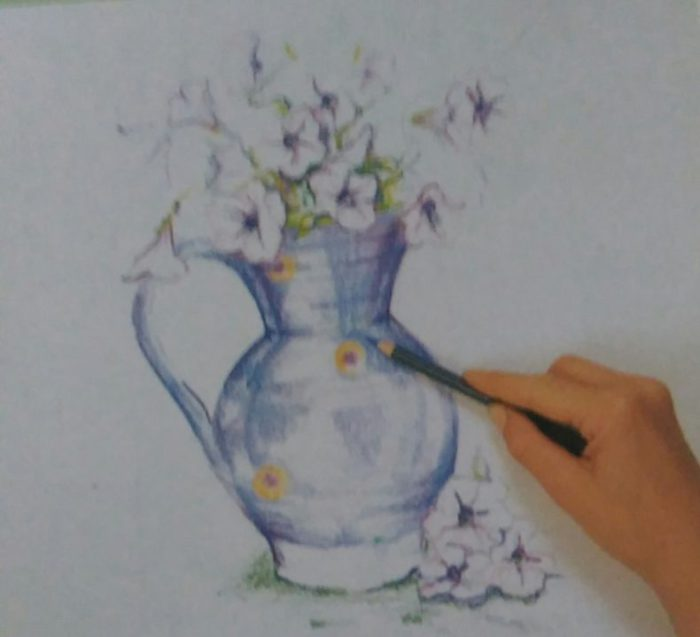 hand drawing a jug with flowers using colored pencils