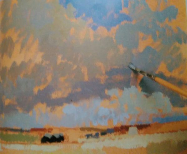 paint brush sketching the sky with oil colors