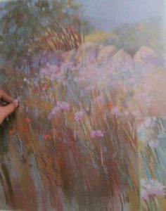 hand finishing the drawing of wild flowers