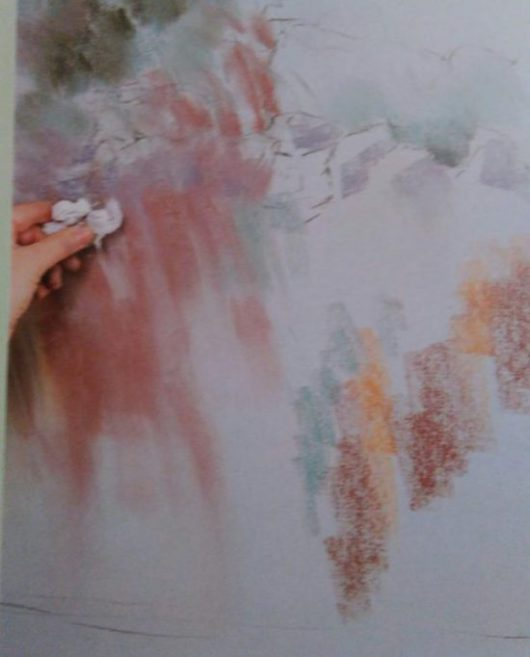 hand smearing the color on a drawing of wild flowers
