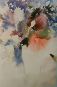 paintbrush painting flowers with watercolors