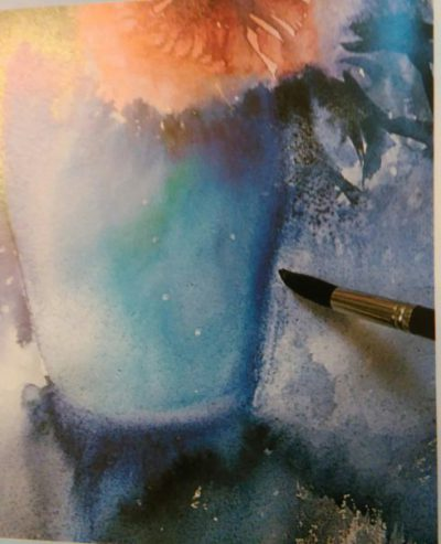 bottom part of a painting of flowers in a vase painted with wartercolors with a brush adding details to the vase