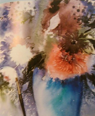 paintbrush adding finishing touches to a painting of flowers in a vase made with watercolors