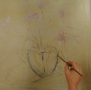 hand with a pintbrush sketching a vase with flowers