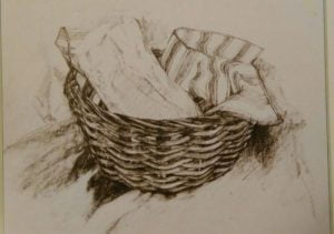 Drawing made with graphite sticks depicting a basket with two pieces of cloth