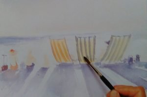 painbrush painting beach chairs with watercolors