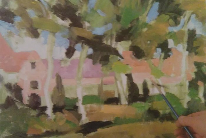 brush adding finishing details to a painting of trees in front of a house