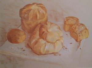 Several loafs of bread on a white surface drawn with conte crayons