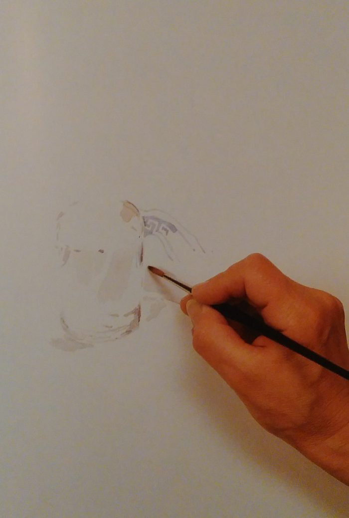 hand sketching a glass jar with flowers using watercolors