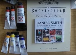 several tubes of Daniel Smith watercolors nets to watercolor paper