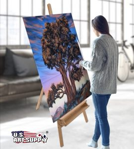 Woman painting on a large canvas mounted on US Art Supply easel