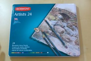 Metal box with Derwent artist colored pencils