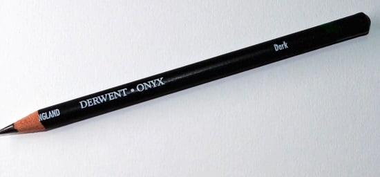 single onyx derwent graphite pencil on a white surface