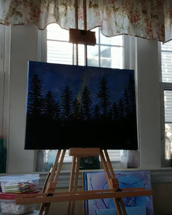 Painting of a landscape mounted on Mon Marte field easel